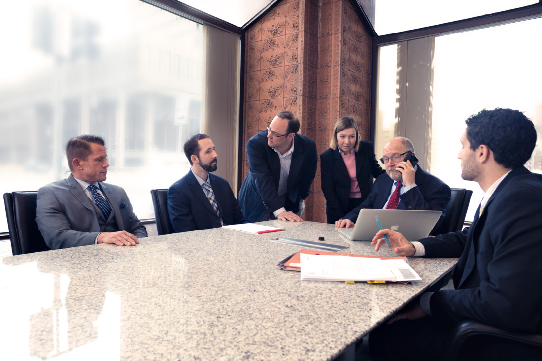 attorneys gathered at conference table
